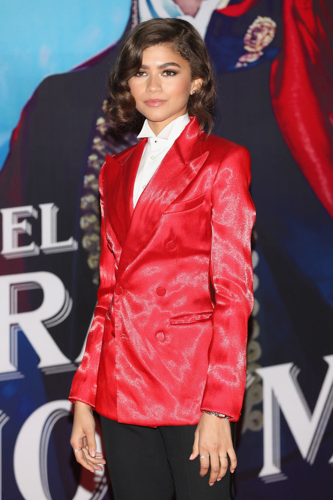 Zendaya wearing a silk blazer that's strikingly similar to the one Hugh Jackman wears in The Greatest Showman.