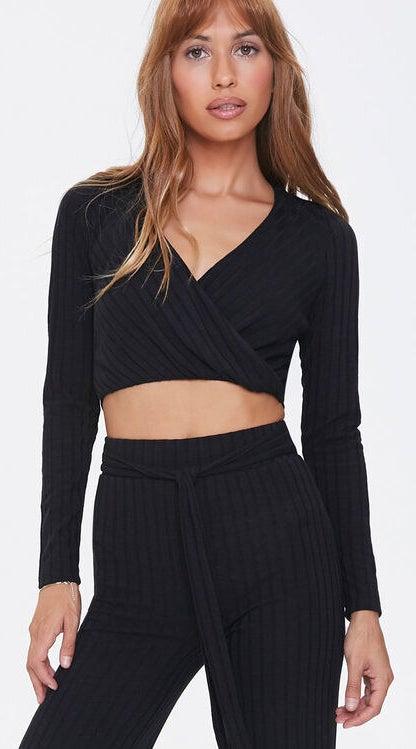 Model wearing black matching set