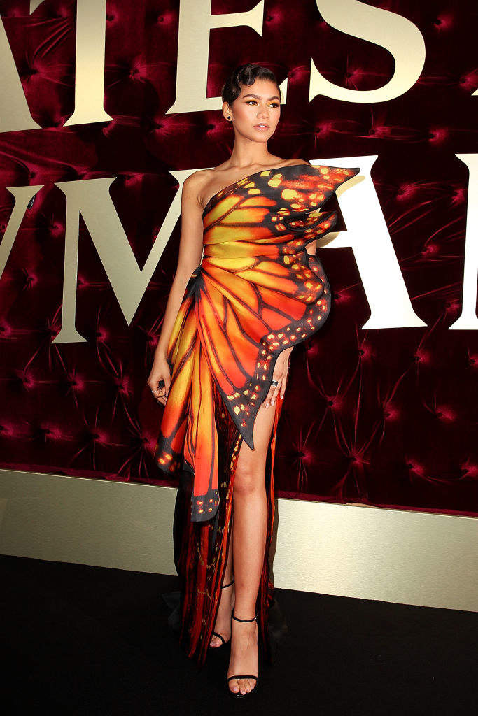 Zendaya posing in a dress that mimics the wings of a butterfly.