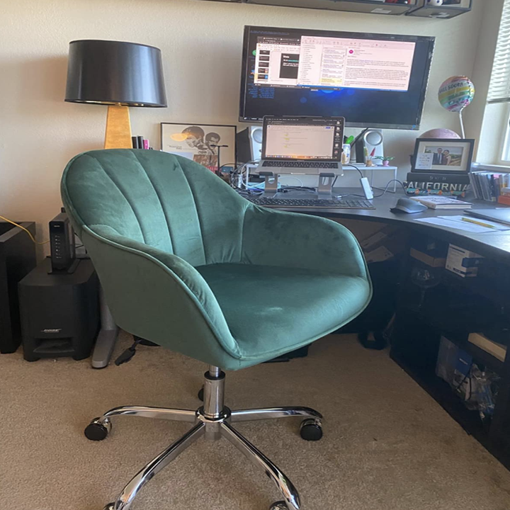 Reviewer image of green velvet swivel arm chair with thin arm rests in front of desk
