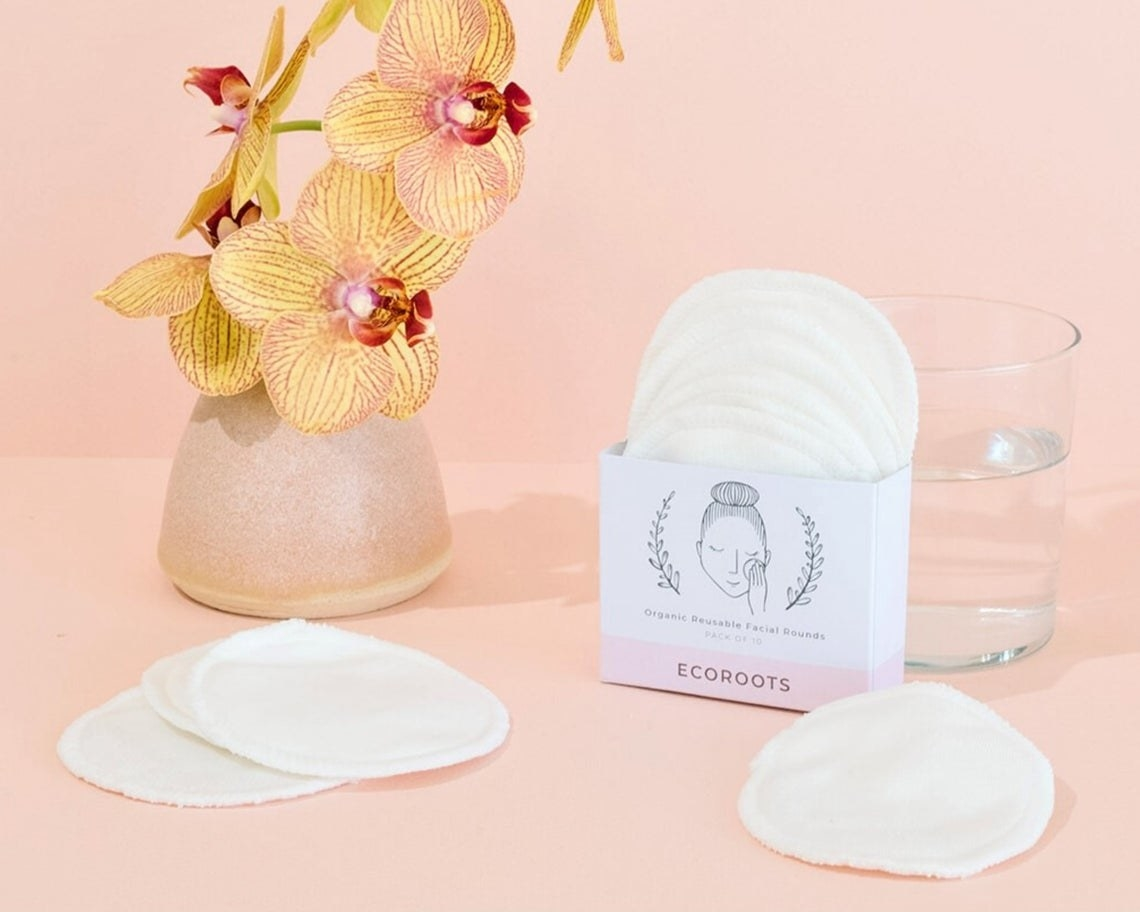 ecoroots makeup remover pads styled next to a vase of flowers