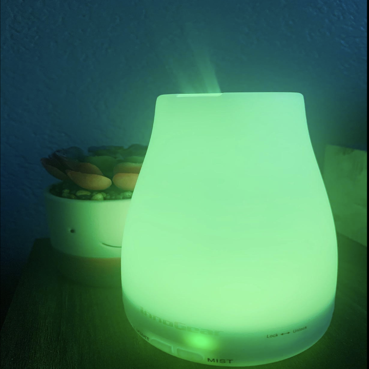 Reviewer image of small diffuser lit up green