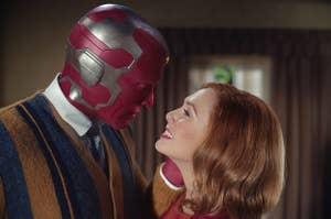 Paul Bettany leans into Elizabeth Olsen's face in WandaVision