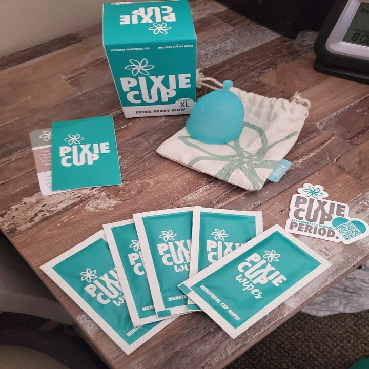 Reviewer pixie cup, box, and wipes on table