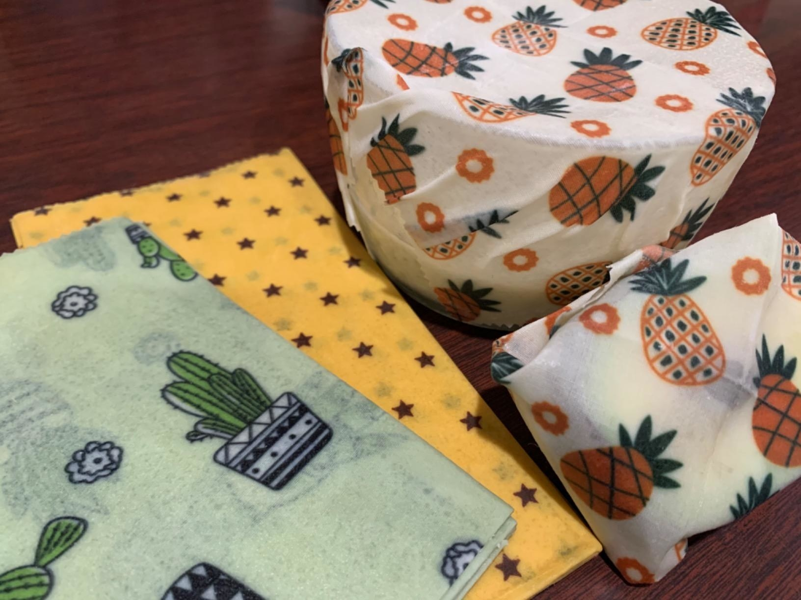 Reviewer using beeswax to wrap fruit and bowls