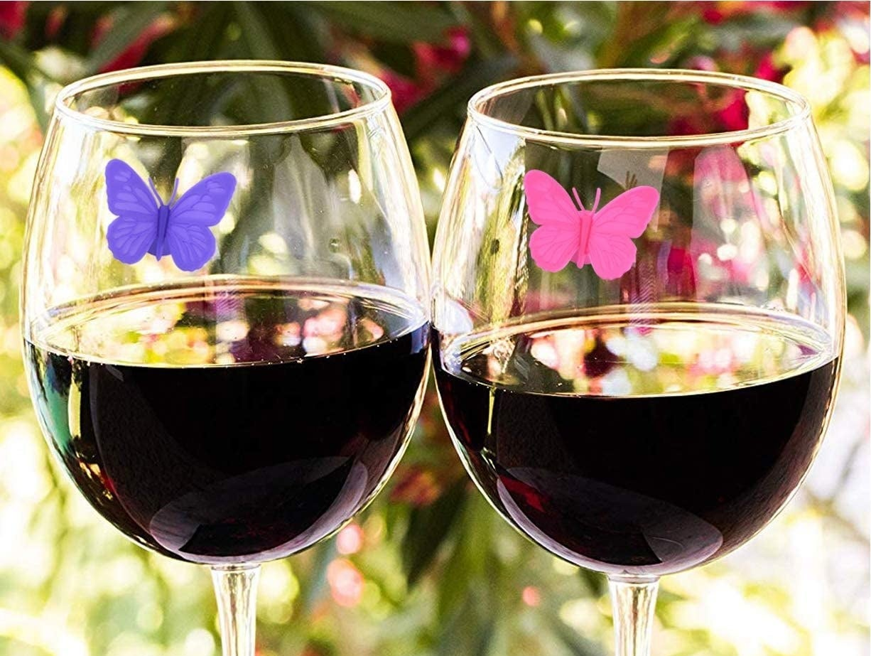 the butterfly markers on two wine glasses
