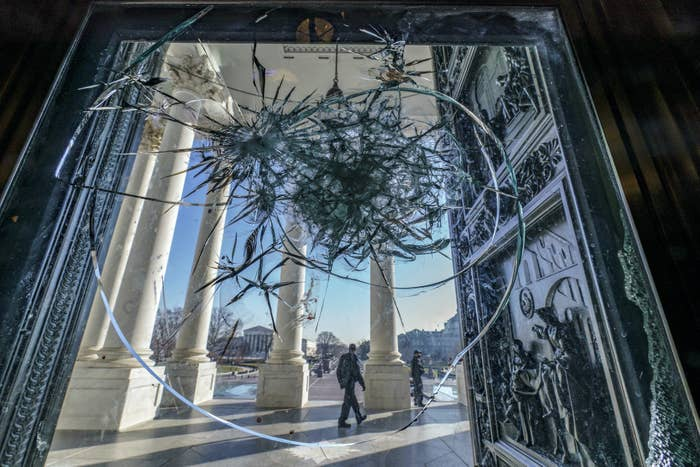 Shattered glass is seen in the doors leading to the Capitol rotunda