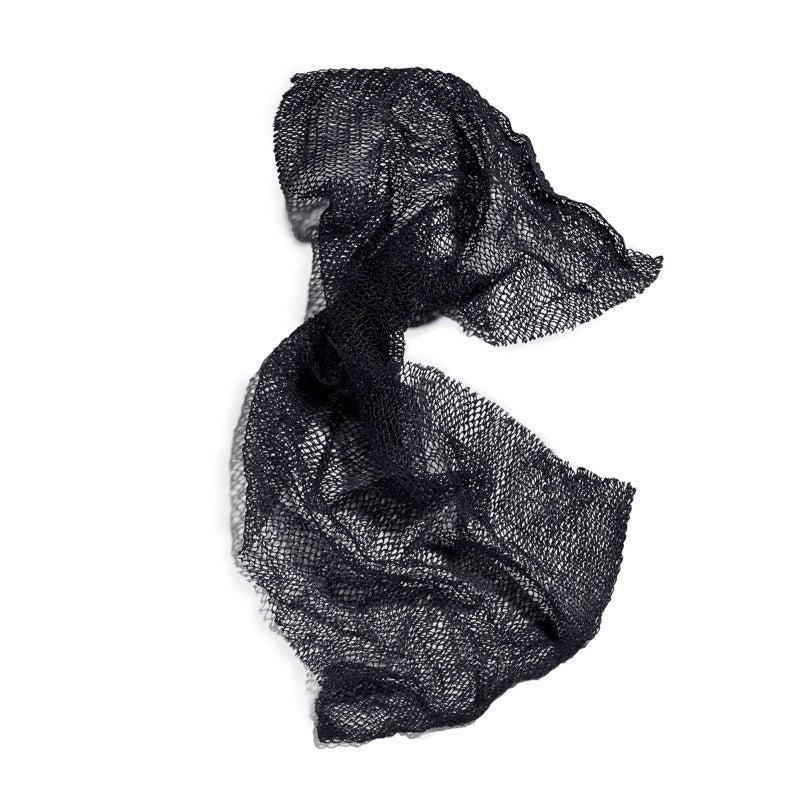 Black mesh exfoliator on white background