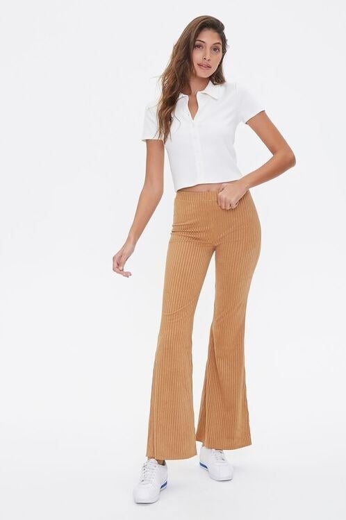 Model wearing the knit flare pants in brown