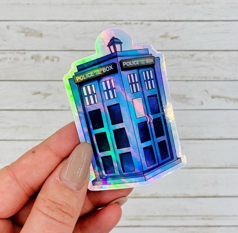 A person holding the holographic TARDIS sticker