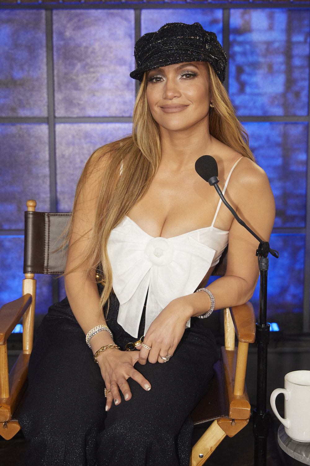 J. Lo sitting in a chair