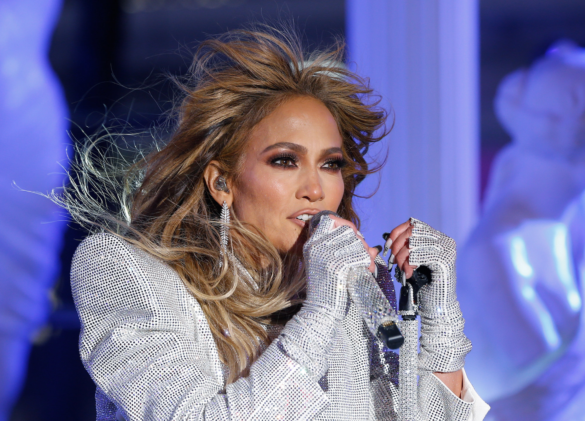 J Lo performing with glowing skin.
