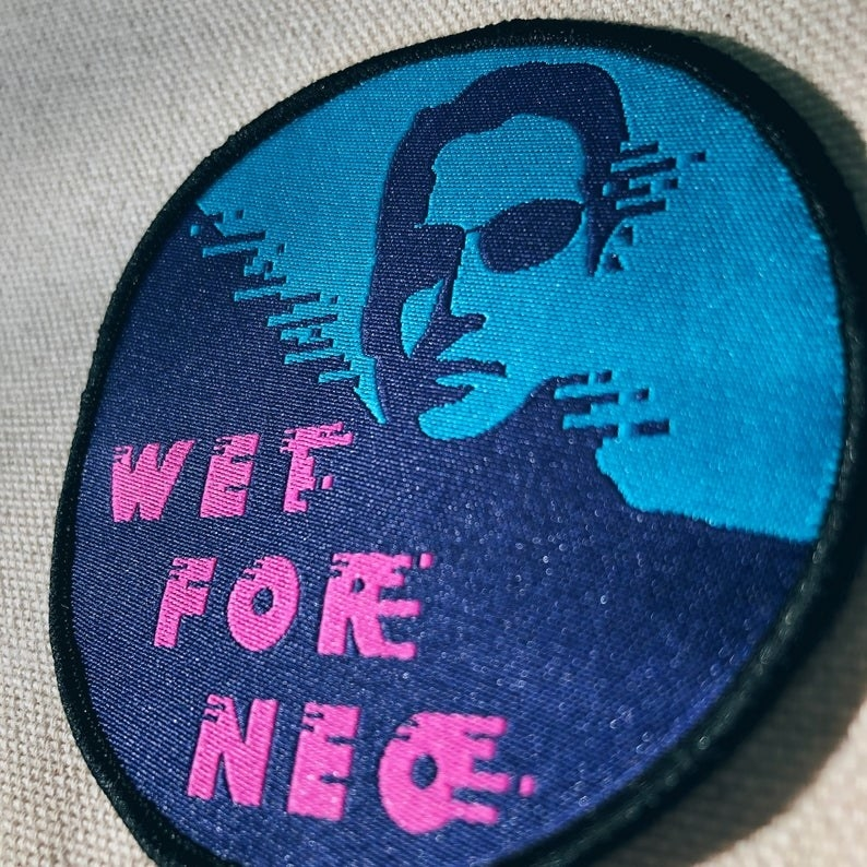 A Matrix patch that says wet for neo on it