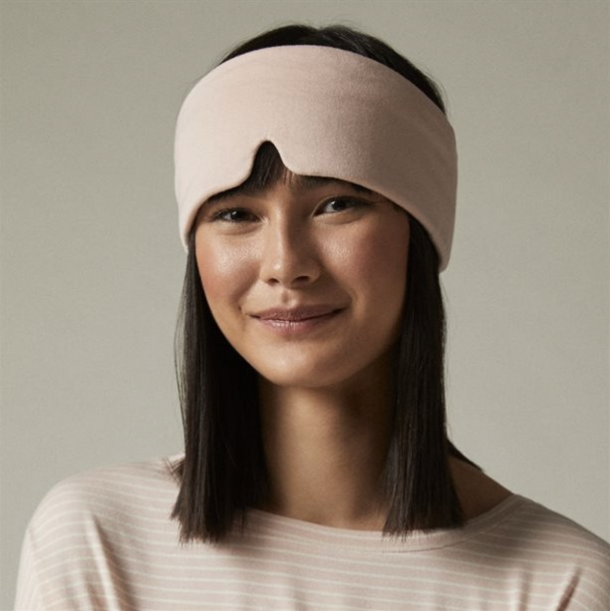 person with the sleep mask on their head