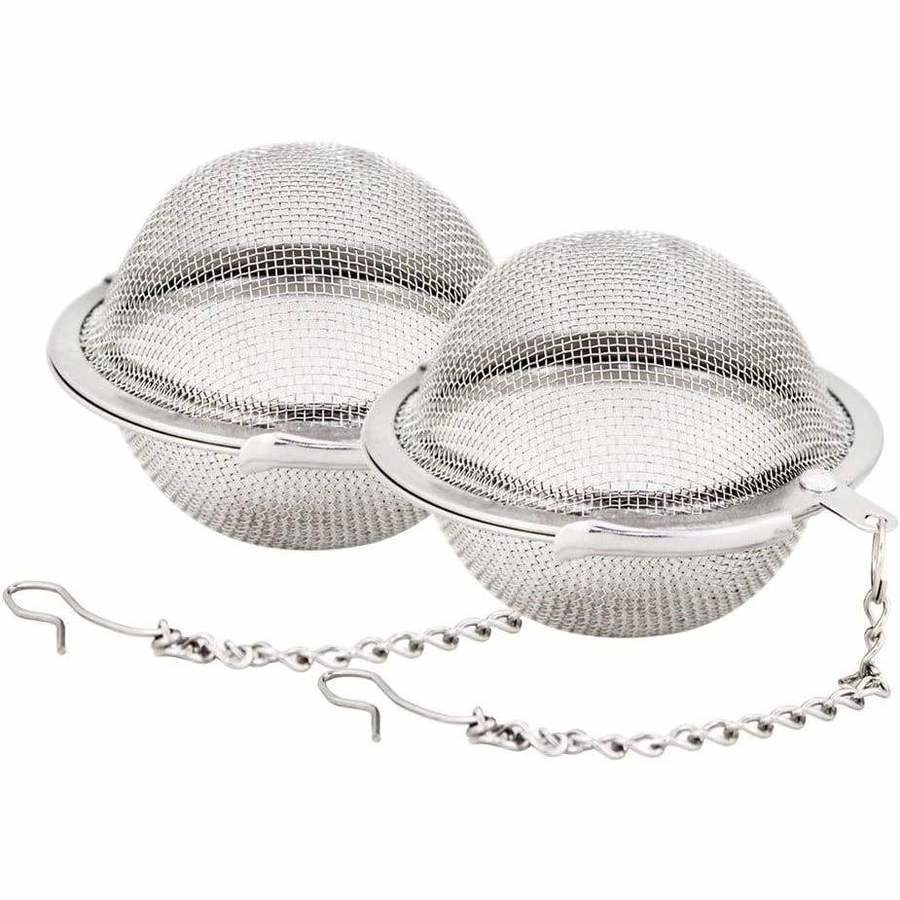 Two tea infusers on white background