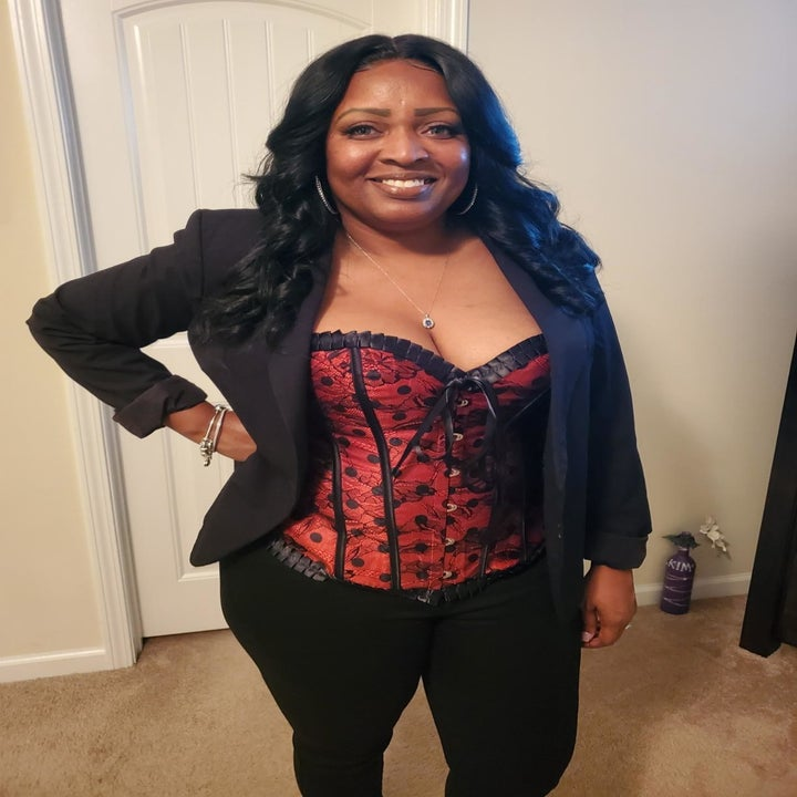 reviewer wearing the bustier in red and black