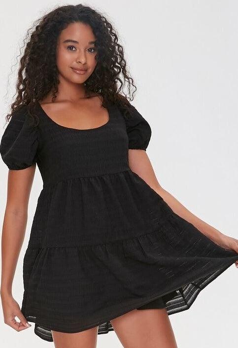 Model wearing a little black dress