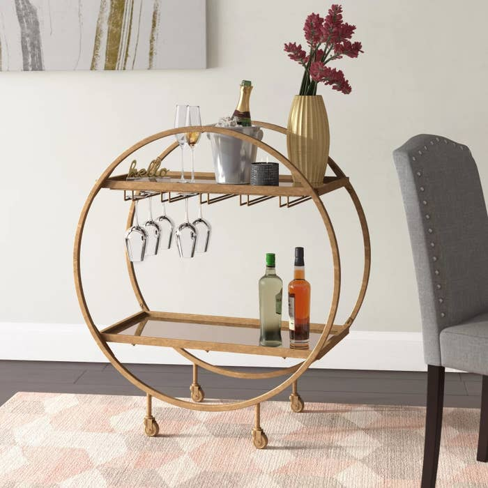 The bar cart with items on shelves