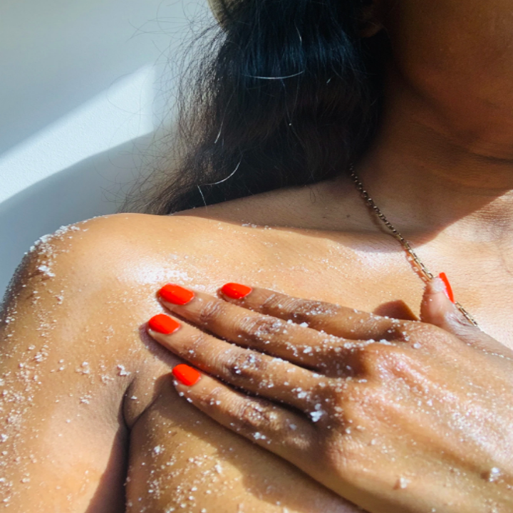 Person applying scrub to body