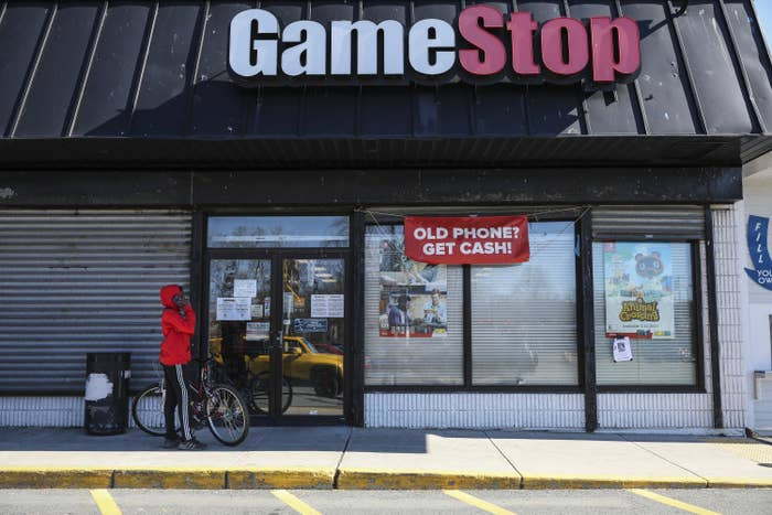 A young boy waits outside of GameStop to pick up a purchase
