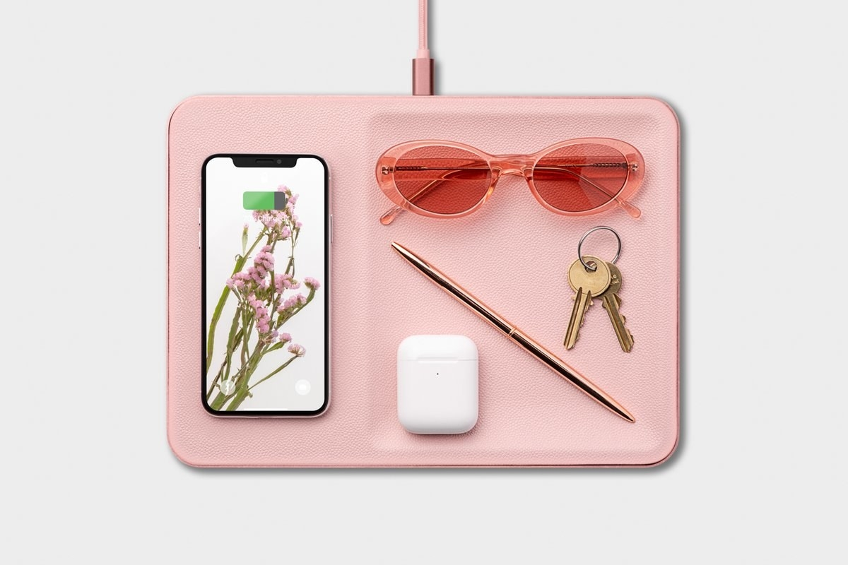 Courant Catch 3 with iPhone, sunglasses, AirPods, pen and keys