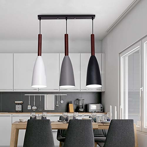 Lamp hanging above a dining table in the kitchen.