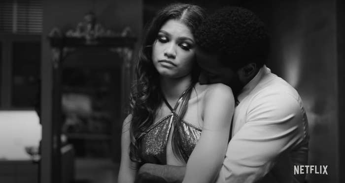 Malcolm (Washington) hugging Marie (Zendaya) from behind while she looks down