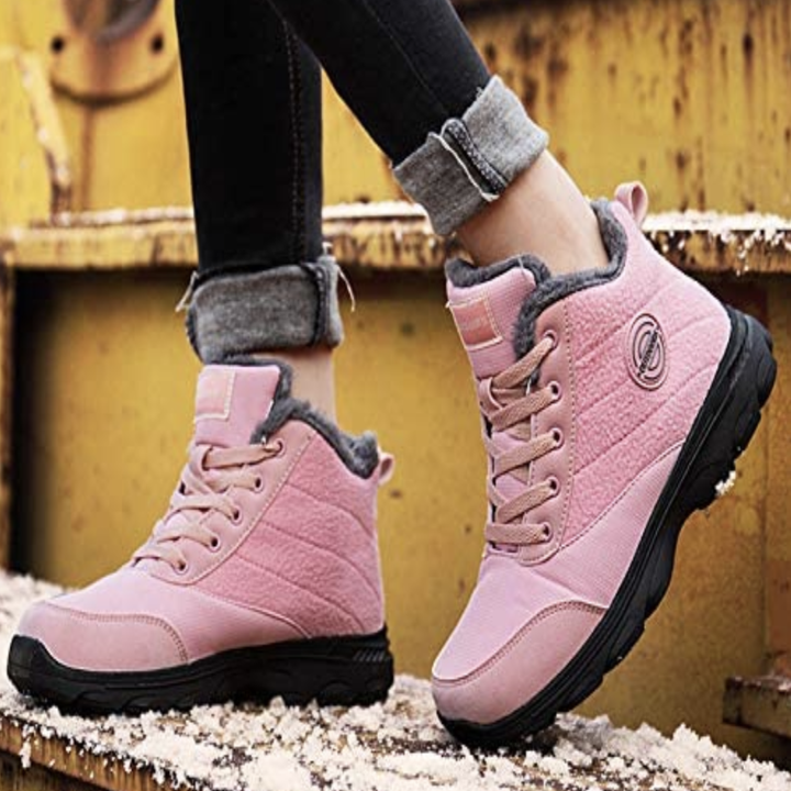 Model in a pair of pastel pink lace up boots