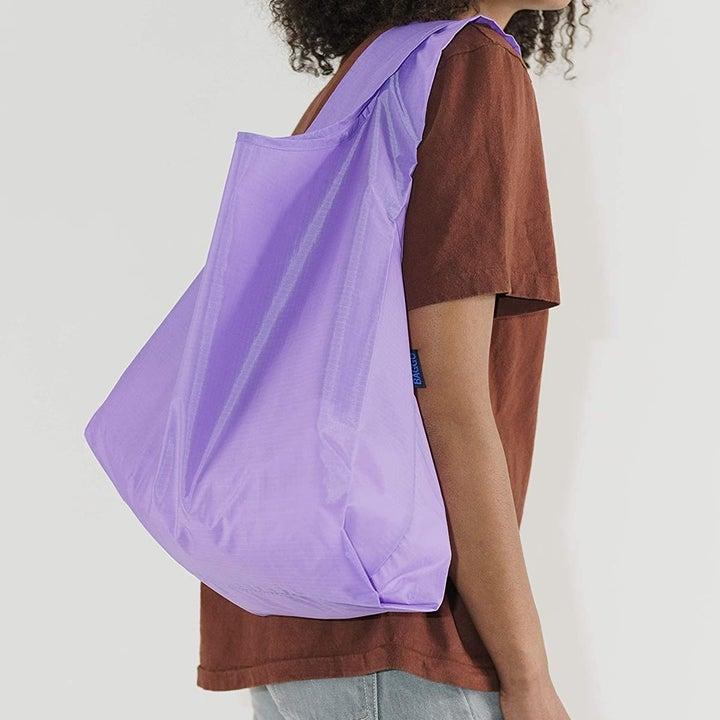 Model wearing bag on shoulder