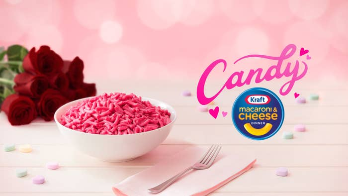 "A Valentine's Day-themed promotional for the pink Kraft mac and cheese that features roses, candy hears, and the word ""Candy"" in fancy lettering"
