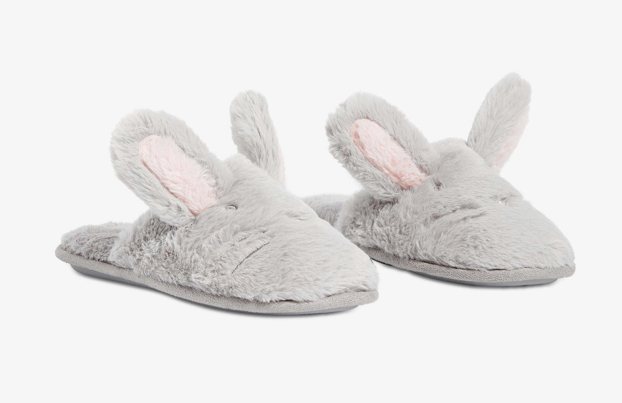 A pair of furry slippers with bunny ears