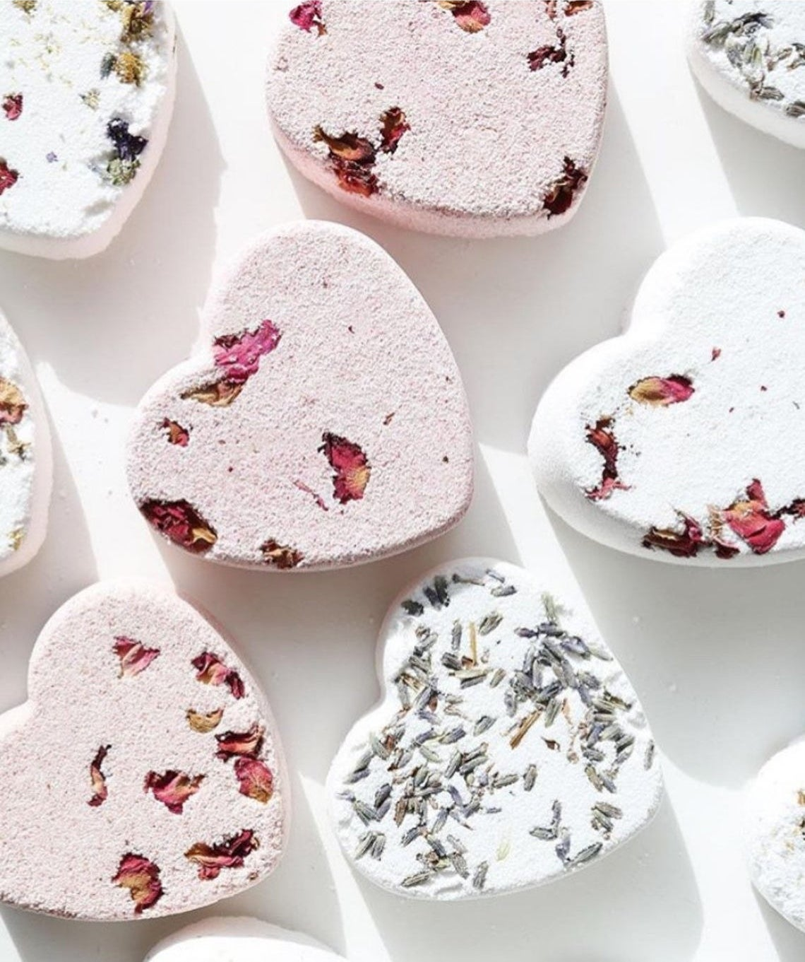 A bunch of heart-shaped bath bombs in a group