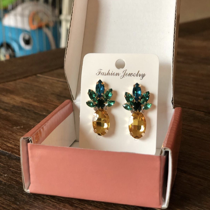 a reviewer photo of the earrings in their packaging