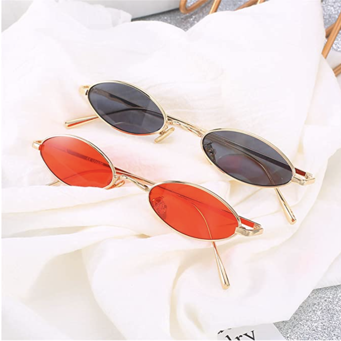 a pair of red and black small sunglasses