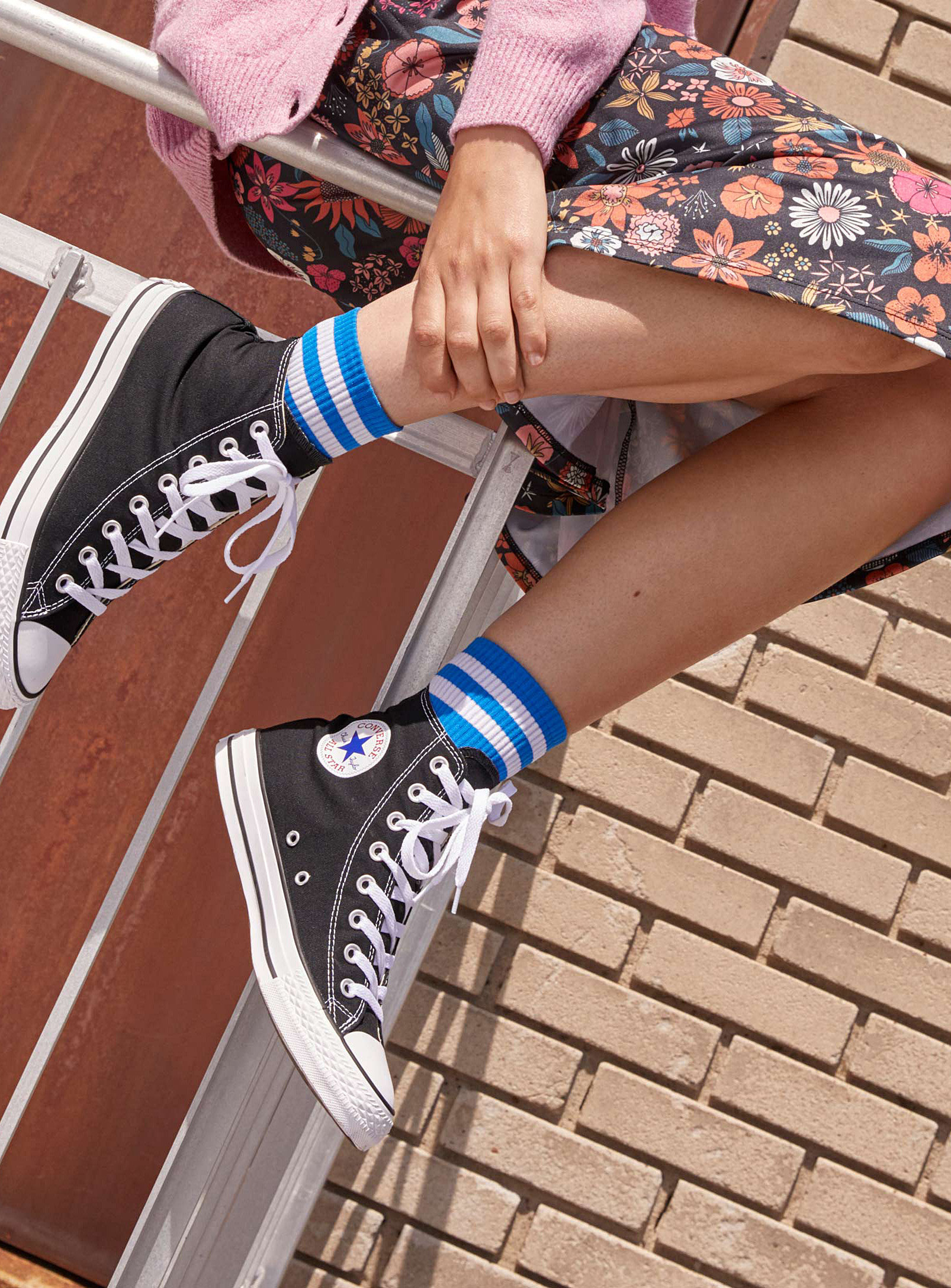 person wearing the converse shoes
