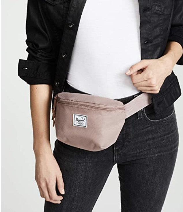 person standing with the fanny pack around their waist