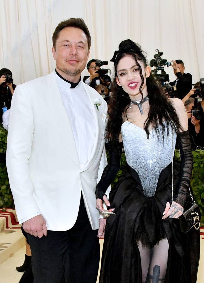 Elon in a suit and Grimes in a hi-lo dress at the Met Gala