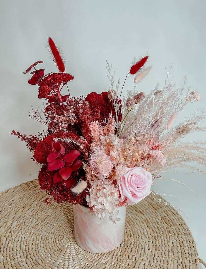 huge bouquet of dried florals in red and pink tones