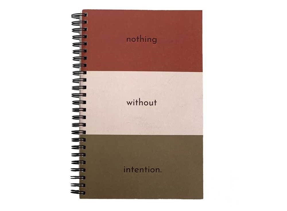 "The journal, with ""nothing without intention"" on the cover"