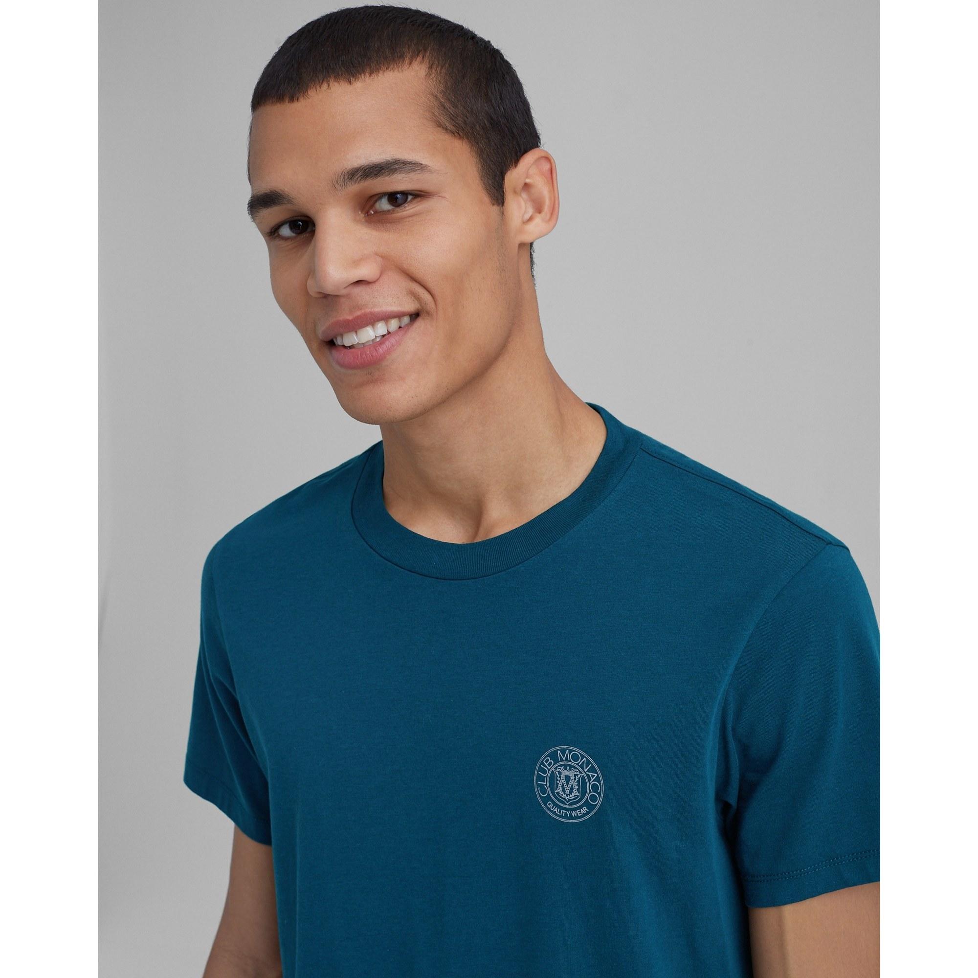 person wearing the club monaco shirt