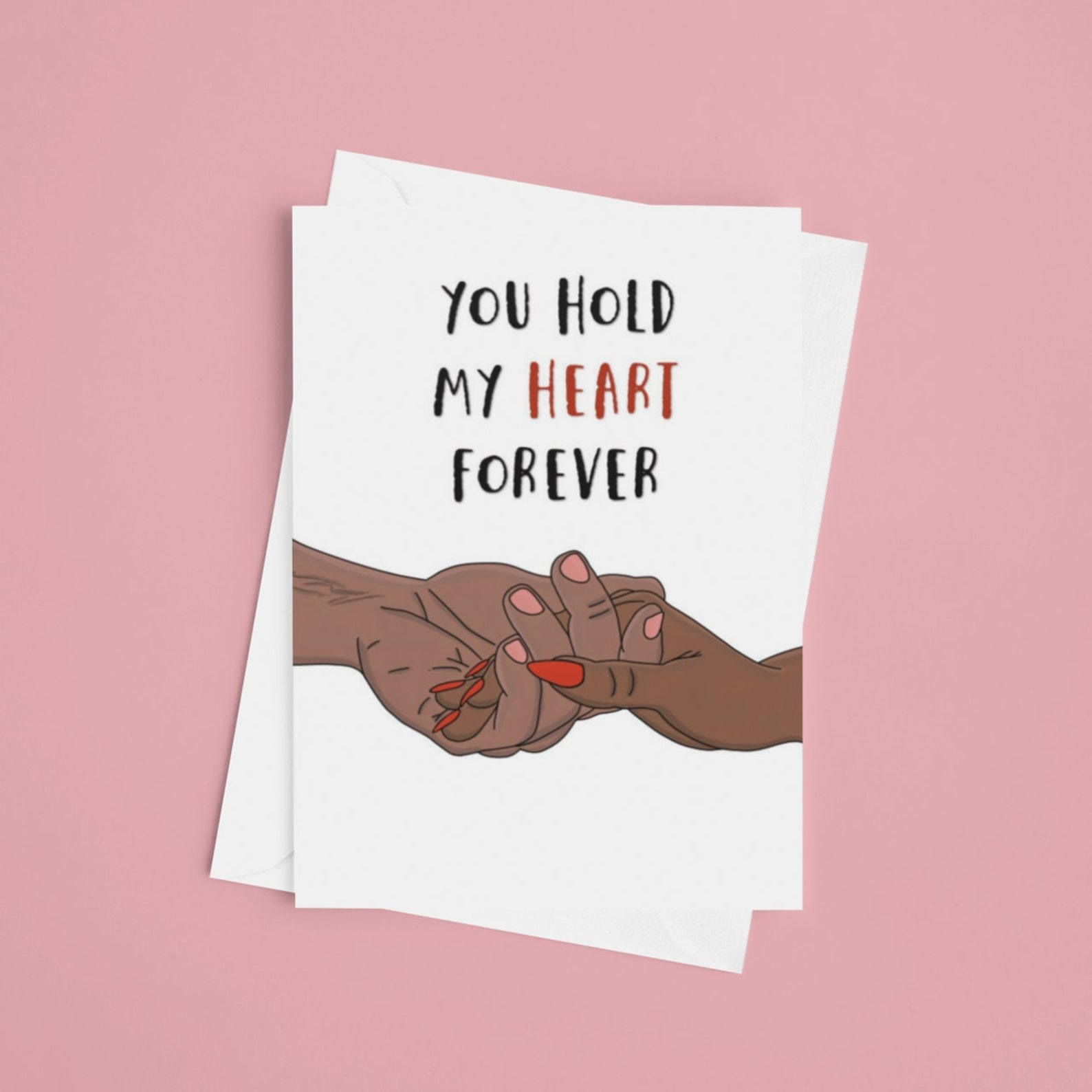 "a white card with illustration of two hands together and the words ""You hold my heart forever"""