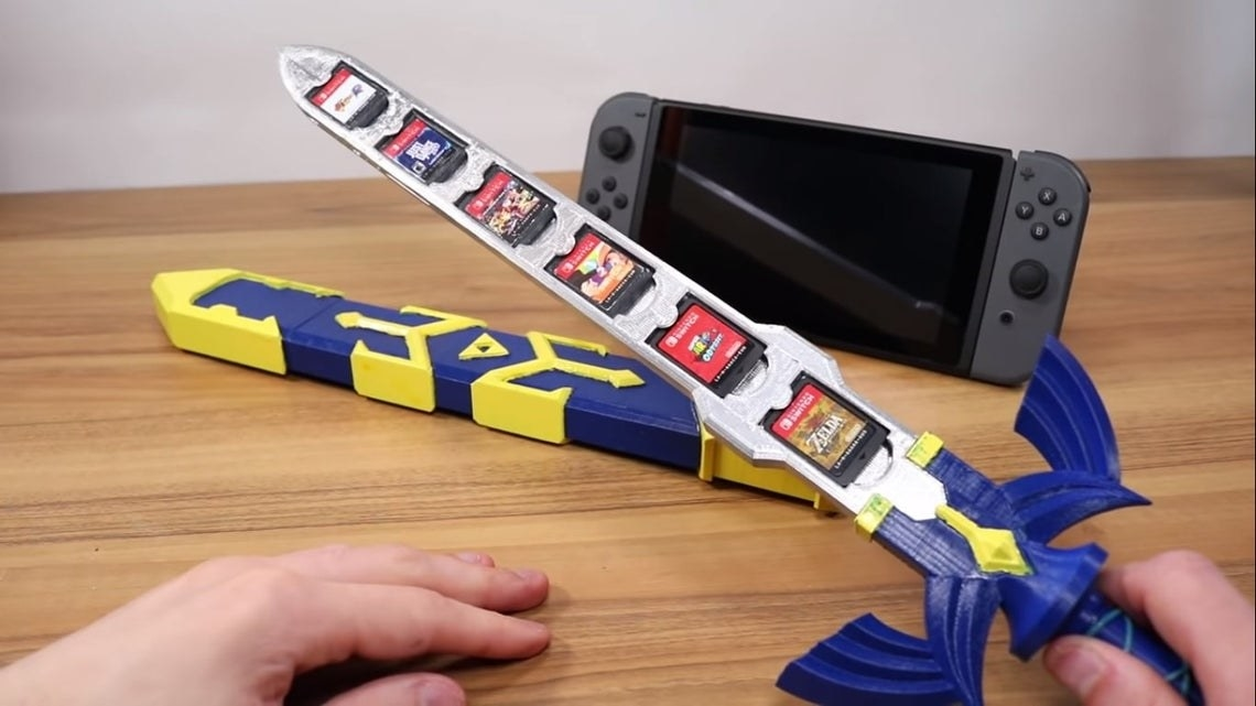 master sword with sheath that has indents to fit six games
