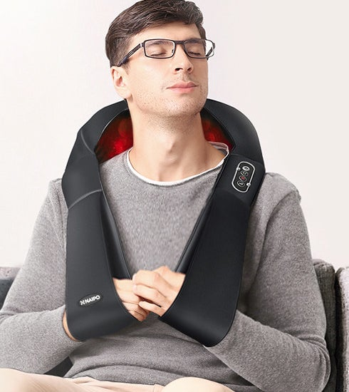 A person using the vest with their arms in the little arm slings