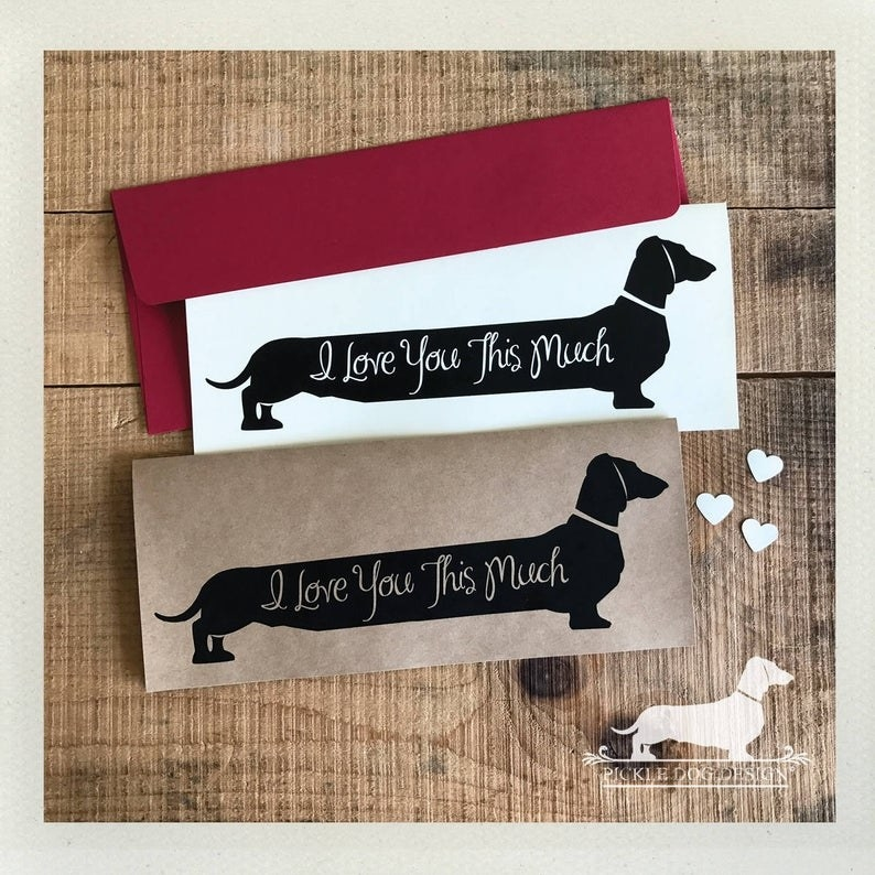 """horizontal card with a Dachshund on it that says """"I love you this much"""" on the dog"""
