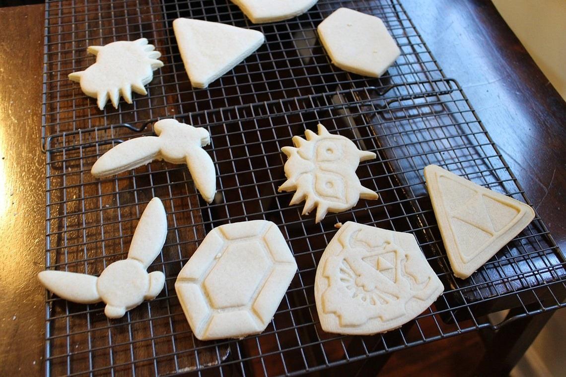 cookies shaped like rupees, shields, triforces, majora, and navi