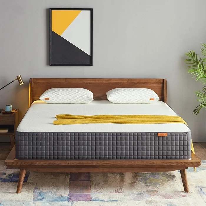 The mattress placed on top of a mid-century modern bed