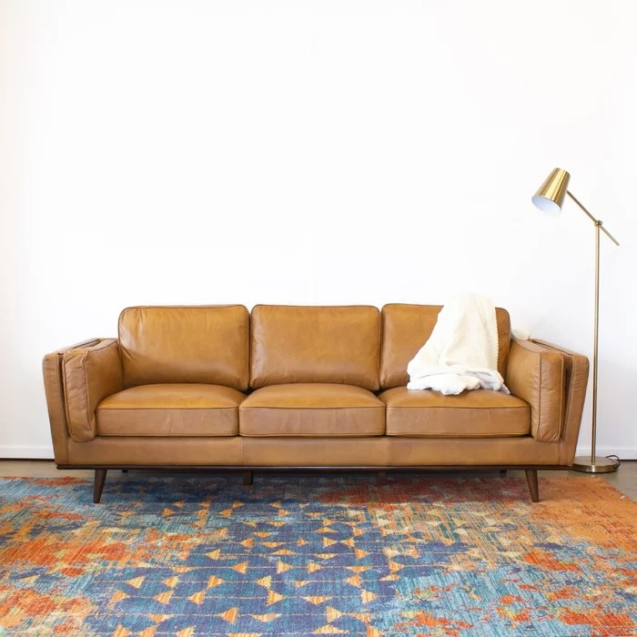 The sofa pushed against a white wall