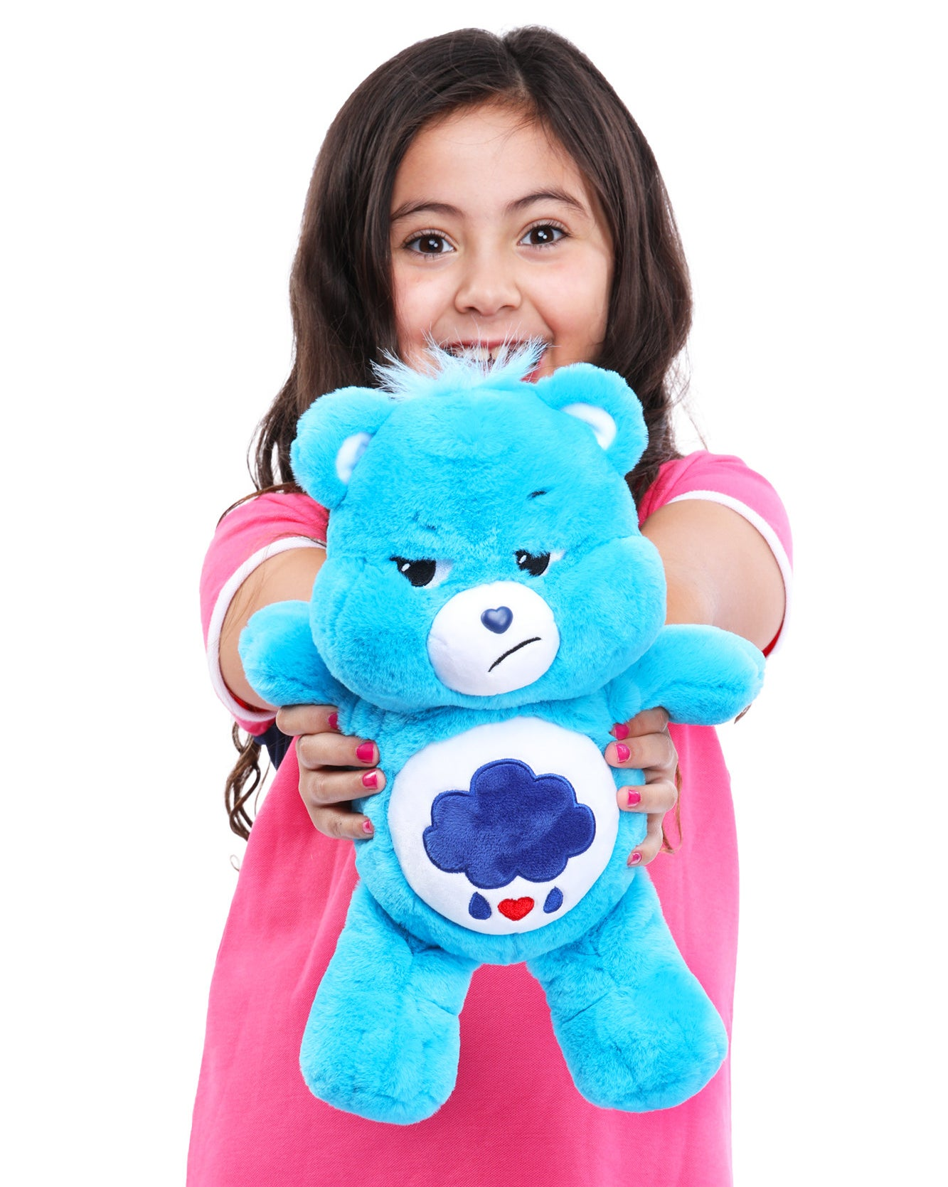 child holding up a blue grumpy-looking care bear