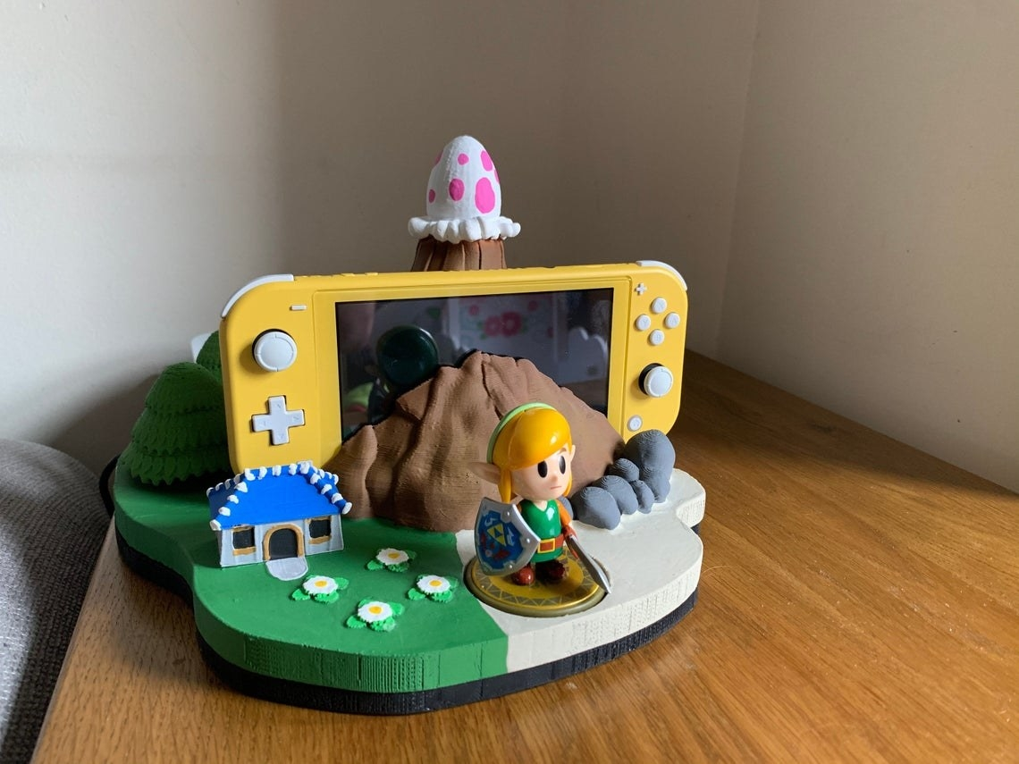 switch dock that looks like the island from links awakening, complete with house, windfish egg, and place for an amiibo