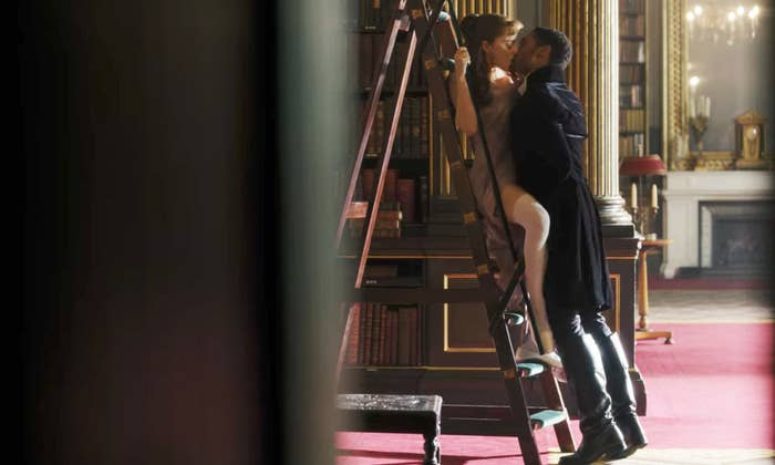 """Daphne and Simon kissing in the library on """"Bridgerton"""""""